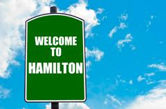 Entrance green road sign with Welcome greeting message - stock photo