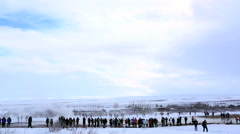 Visitors at the geyser eruption of Strokkur, Iceland Stock Footage