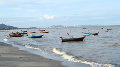 Old Wooden Fishing boats on Sea Coast in Waves Stock Footage