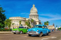 Stock Photo of Classic American cars and Capitol in  Havana, Cuba