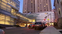 Hospital exterior at dusk Stock Footage