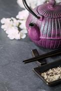 Chinese  Set, teapot, chopsticks and sakura branch Stock Photos