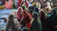 Traditional covered women at festival, India, medium shot Stock Footage