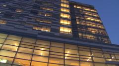 Pan between buildings at dusk Stock Footage