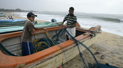Fishermen (father and san) on the popular surf beach Arugam Bay Stock Footage