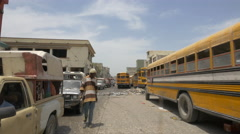 Yellow school buses on a street in Port-au-Prince Stock Footage