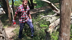 lumberjack is chopping dry tree - stock footage