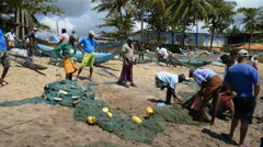 Sri Lankan fishermen working on the beach, Sri Lanka, Tangalle. Stock Footage