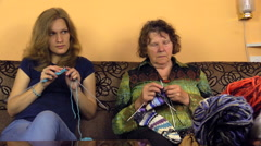Old grandma and young woman knit and balls of wool thread Stock Footage