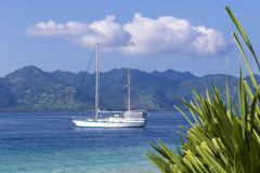 Boat at Paradise Tropic Island. - stock photo