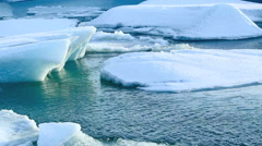 Ice floe breaks down at the glacier lagoon Jokulsarlon in slow motion Stock Footage
