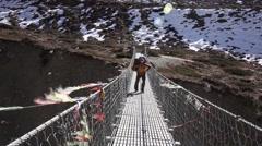 Suspension bridge on Annapurna Circuit Stock Footage