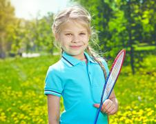 Girl with tennis racket Stock Photos