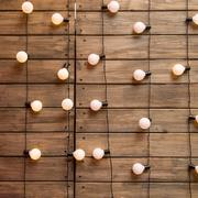 Wood wall with edison light bulb - stock photo