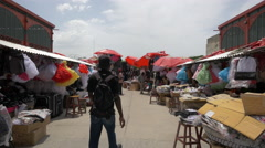 Crowded stalls in a market in Haiti Stock Footage