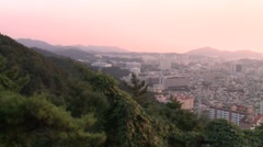 Gwangju during sunset, pink light, pan Stock Footage