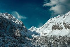 Stock Photo of Beautiful mountains view at winter under sky.