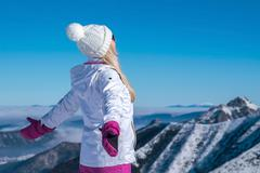 Stock Photo of Female stay on the top of mountain with beautiful view