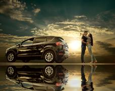 Happiness couple stay near the new car under sky with reflex Stock Photos