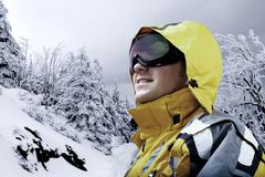 Stock Photo of Portrait of man wearing a helmet and glasses on the background of snow winter