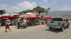 Stalls with red umbrellas in a food market in Haiti - stock footage