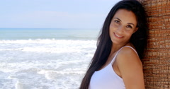Woman at the Beach Leaning Against Tree Trunk Stock Footage