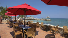 Restaurant with red umbrellas near the beach in Jamaica Stock Footage