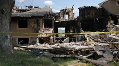 House after a large fire - stock footage