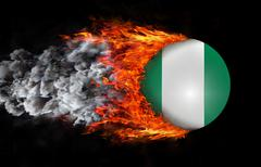 Stock Illustration of Flag with a trail of fire and smoke - Nigeria