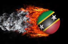 Stock Illustration of Flag with a trail of fire and smoke - Saint Kitts and Nevis