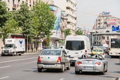 Rush Hour Traffic In Downtown Roman Square Stock Photos