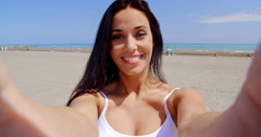 Young brunette woman smiling while making a selfie Stock Footage