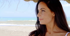 Brunette Woman in Shade on Tropical Beach - stock footage