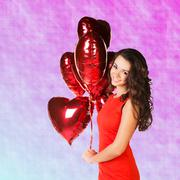Stock Photo of Woman with valentine baloons