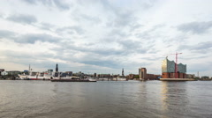 Philharmonic building and Sankt Michaelis Church in the evening with elbe river Stock Footage