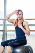 Beautiful young woman girl after physical excercise in fitness center gym - stock photo