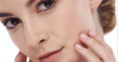 Beauty portrait of woman touching beautiful face in slow motion skincare concept - stock footage