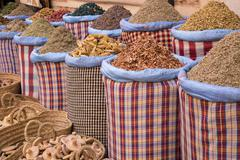 Bags of herbs and spices for sale in souk in the old quarter, Medina, Marrakesh, - stock photo