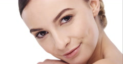 Beauty portrait of woman touching beautiful face in slow motion skincare concept Stock Footage