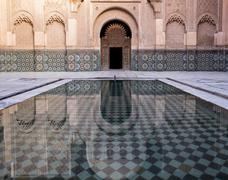 Reflections in the courtyard pool, Medersa Ali Ben Youssef (Madrasa Bin Yousuf), Stock Photos