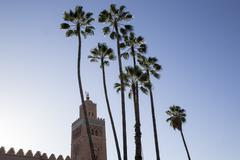 Minaret of Koutoubia Mosque with palm trees, UNESCO World Heritage Site, - stock photo
