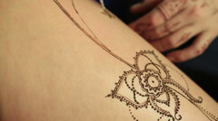 Henna body painting. View of process, close-up Stock Footage
