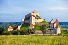 Stock Photo of Old medieval fortress on top of the hill, Rupea village located in Transylvan