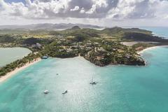 Aerial view of sailboats moored a few meters from the coast of Antigua, Leeward Stock Photos
