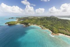 Aerial view of the rugged coast of Antigua full of bays and beaches fringed by Stock Photos