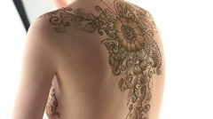 View of female naked body decorated with henna - stock footage