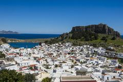 Panoramic view of beautiful Lindos village with its castle (Acropolis), Rhodes, Stock Photos