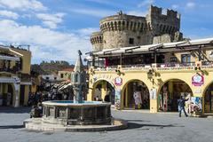 Medieval fountain at Hippokratous Square, the Medieval Old Town, UNESCO World - stock photo
