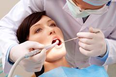 Examining oral cavity Stock Photos