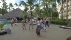 Locals and tourists dancing at a hotel in the Dominican Republic Stock Footage
